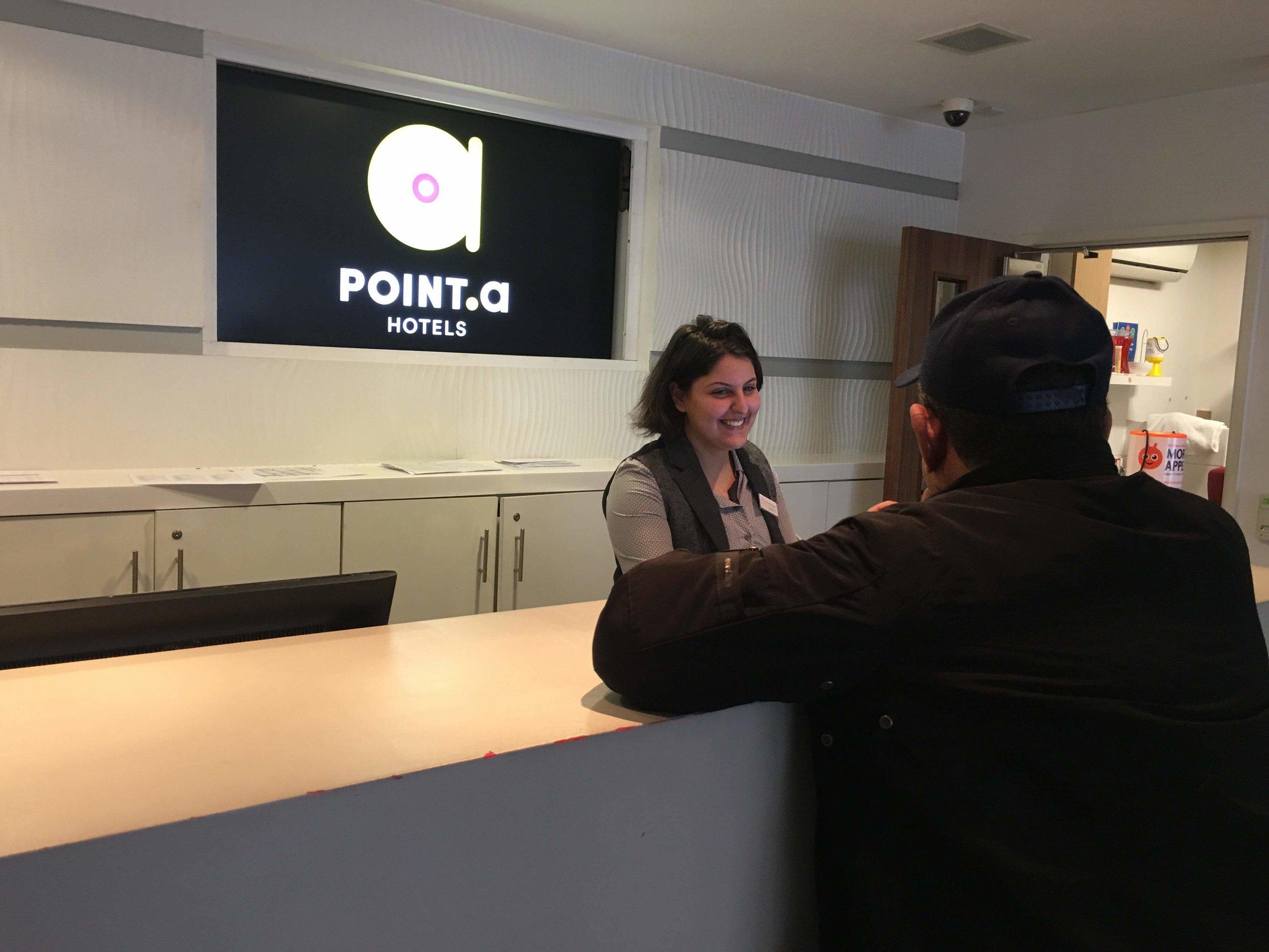 Samira welcomes a customer at Point A Hotels