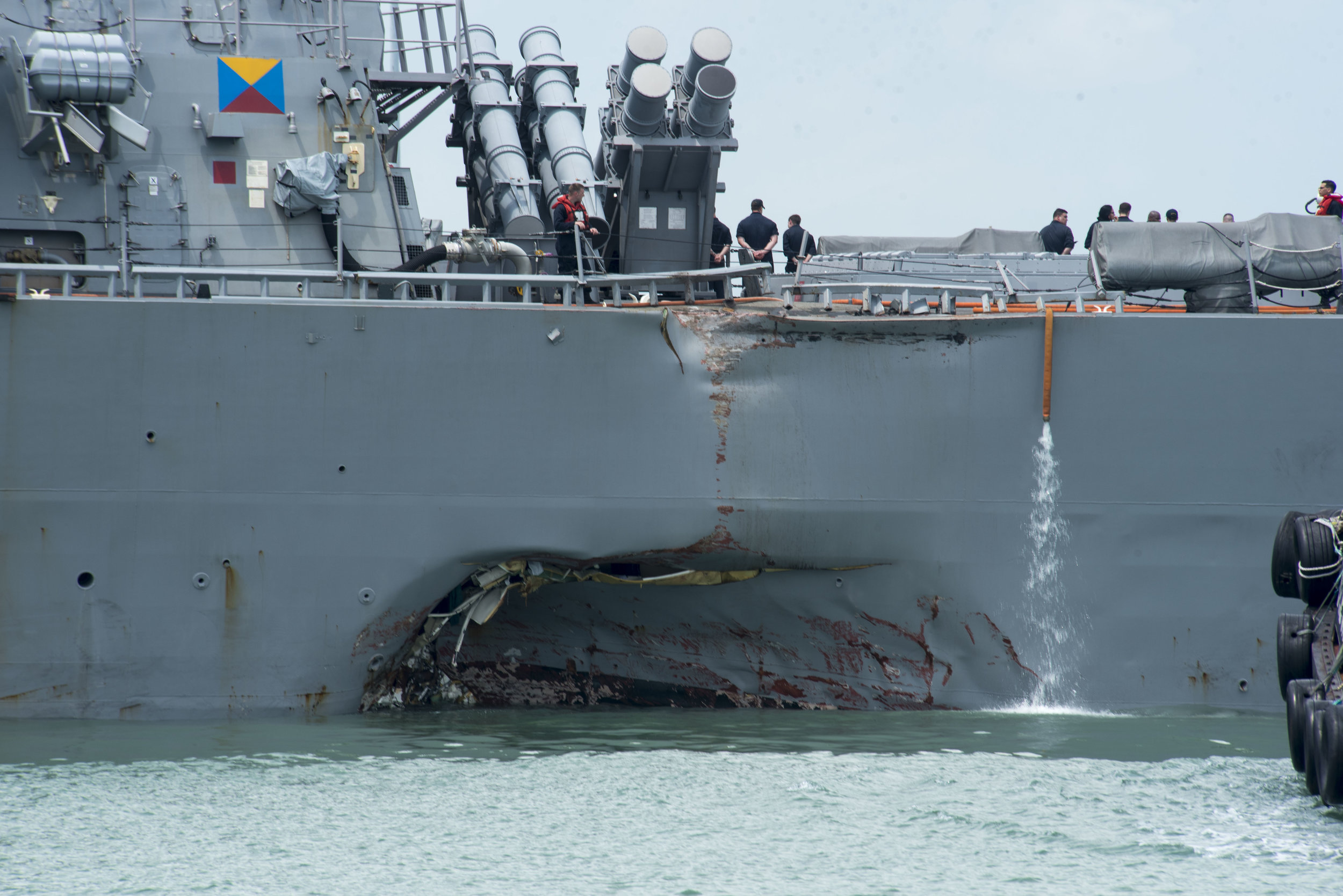 Aug. 21, 2017--Damage to the port side of the guided-missile destroyer USS John S. McCain (DDG 56) as it steers towards Changi Naval Base, Republic of Singapore, following a collision with the merchant vessel Alnic MC. Photo by Mass Communication Specialist 2nd Class Joshua Fulton. The appearance of U.S. Department of Defense (DoD) visual information does not imply or constitute DoD endorsement.