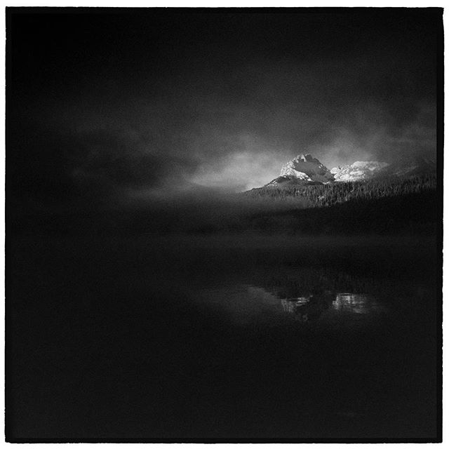 The fog rolled out and let the mountains through. Redfish Lake, Sawtooth National Recreation Area, Idaho. * * * * * * * * * @mypubliclands @usinterior #mypubliclands #keepitpublic #protectourpubliclands #findyourpark #usinterior #protectthewild #aperturefoundation #lensculture #blackandwhite #holga #filmisnotdead #mediumformat #filmphotographic #documentary #idaho #afar #thegreatoutdoors #wildernessculture #americanwest