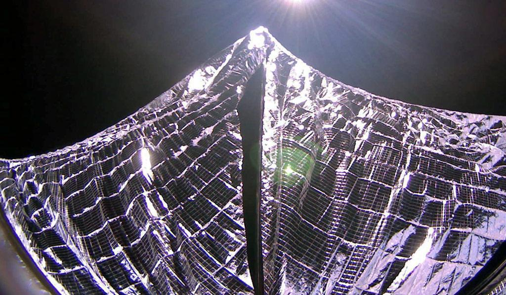 Image of the deployed solar sails in earth orbit.