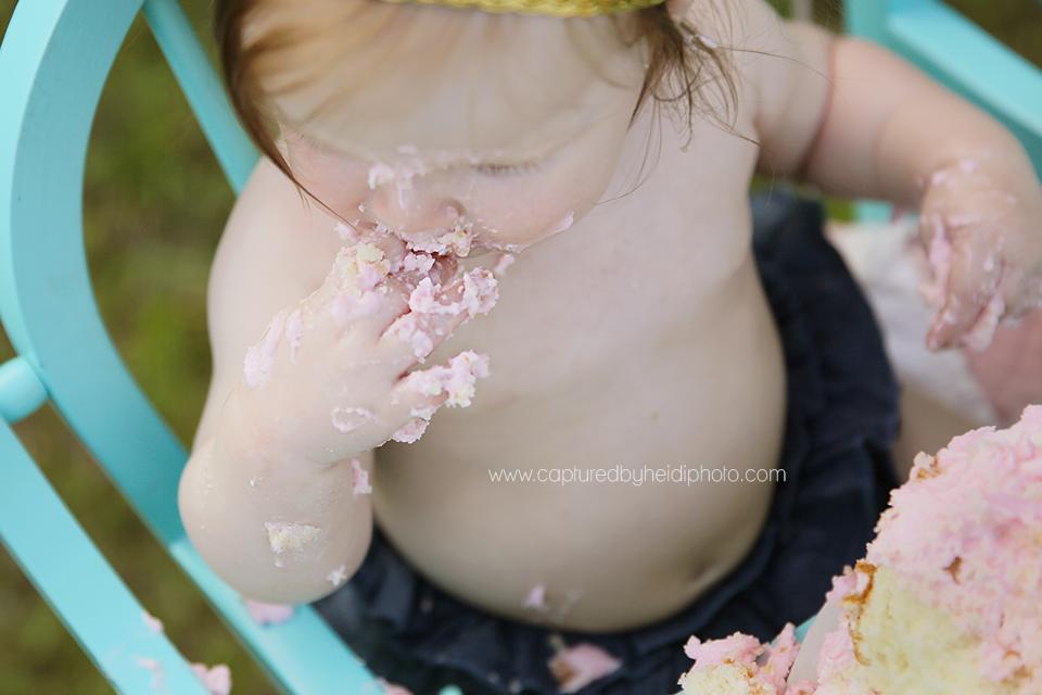 8-central-iowa-baby-photographer-cake-smash-high-chair-big-balloon-pink-cake-huxley-yellowbanks-desmoines.png