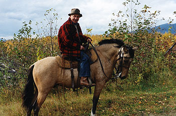 """Dr. Betkowski riding his favourite horse """"Lino"""": Upper Fraser Ranch"""
