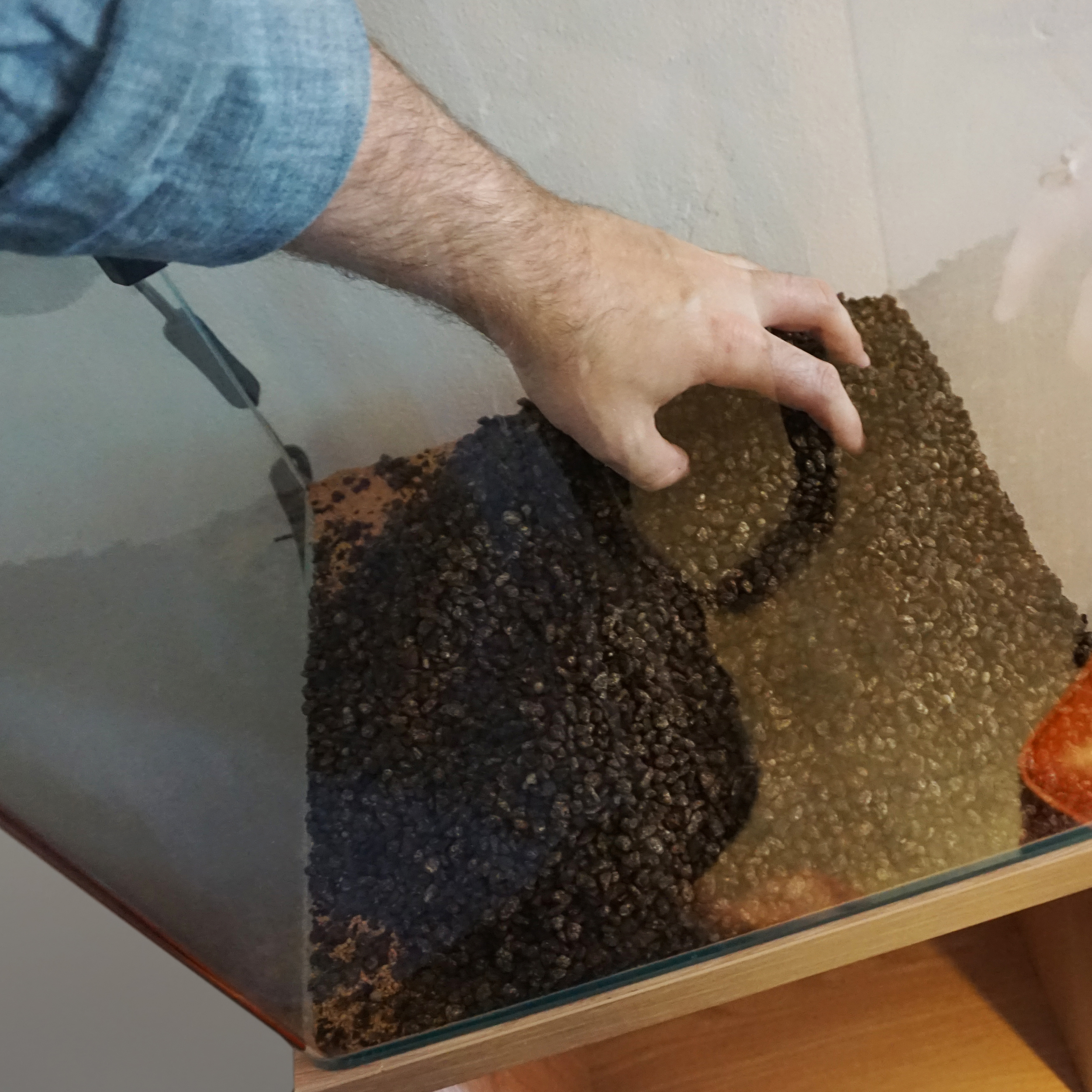 """Laying in the Power Sand needs only to be done in a manner which gives you no more than 1"""" of coverage. Often times the aquascaper will leave a 1"""" perimeter around the aquarium free of Power Sand, This is done so that you do not see it under the main substrate once the tank is complete."""