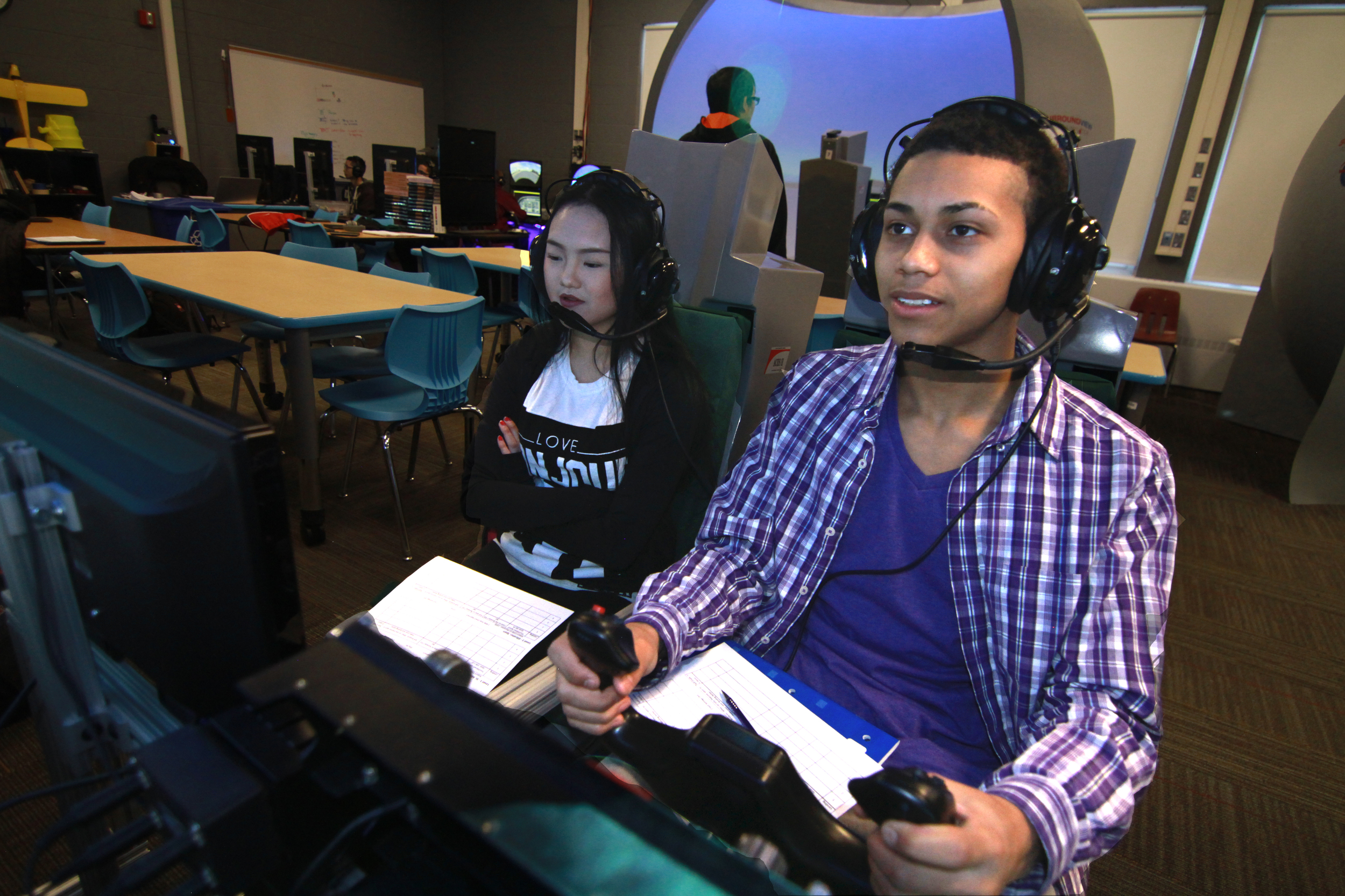 Students working together, Dual Seat Flight Simulator