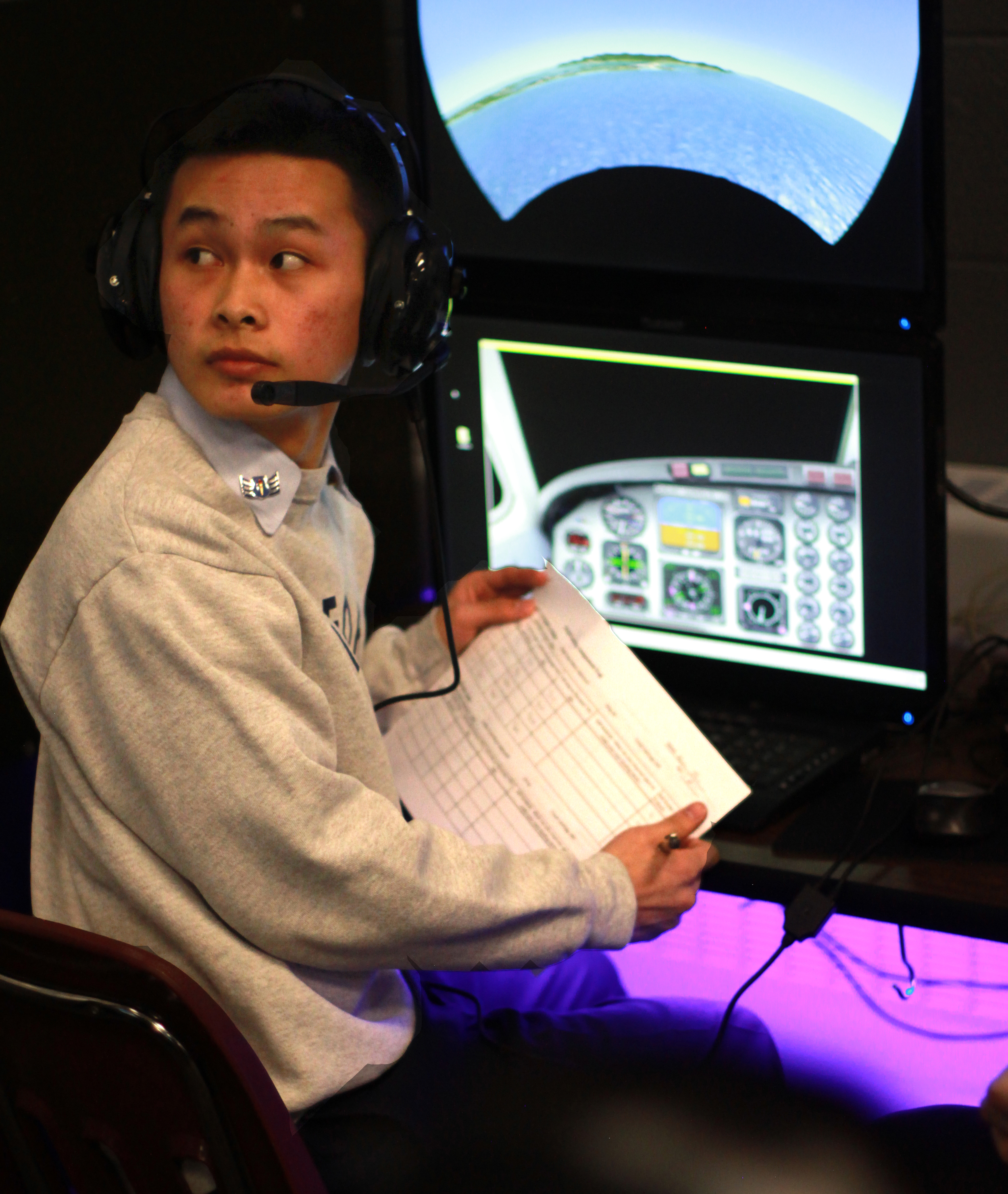 Student Flight Controller at Flight Control Station (FCS)