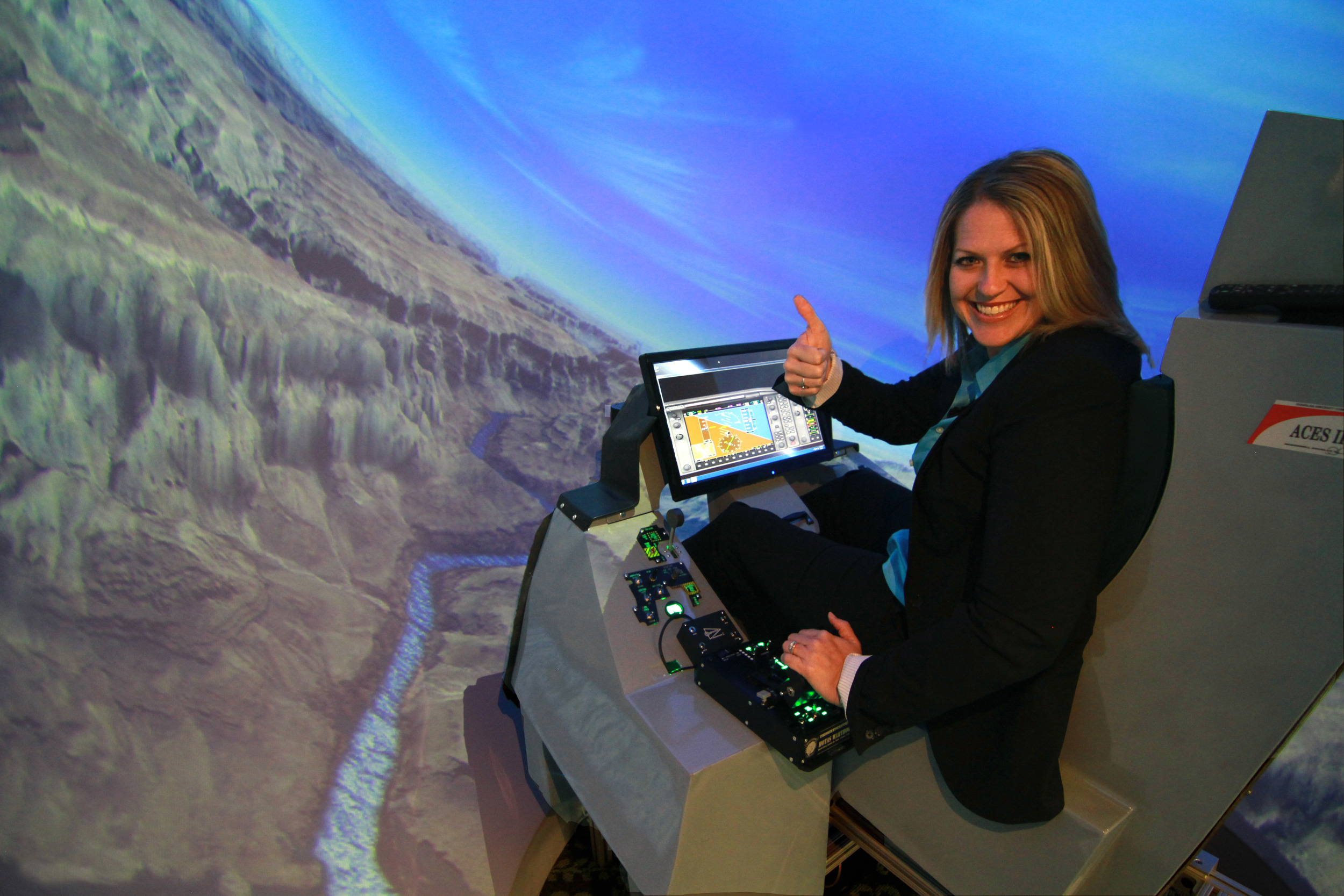JSAA AEROSPACE COORDINATOR CAMI DEBISE TEST FLIES THE SURROUND VIEW FLIGHT SIMULATOR OVER THE GRAND CANYON