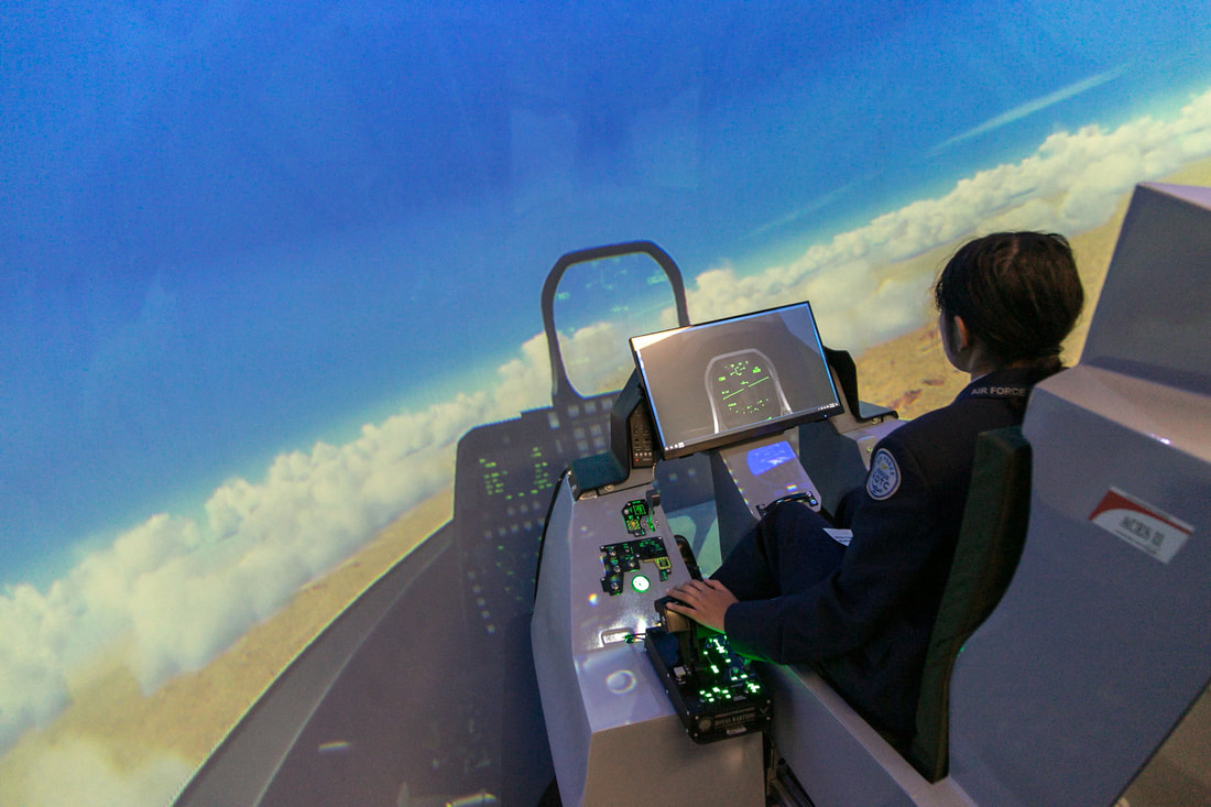 Student piloting an F-35 over the Grand Canyon in Surround View