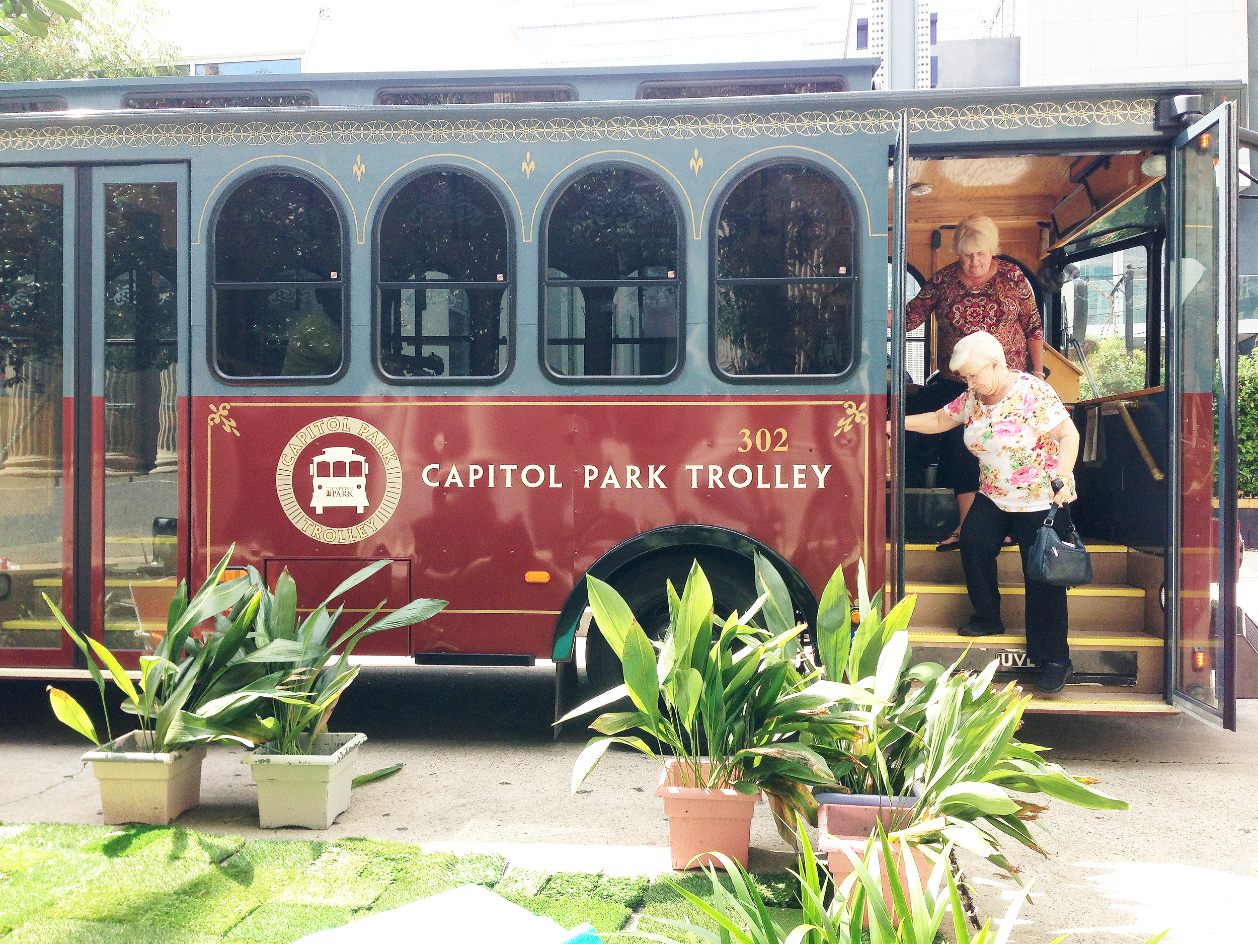 Riders are met by a PARK(ing)Day installation outside a stop on the Capitol Park Trolley route.