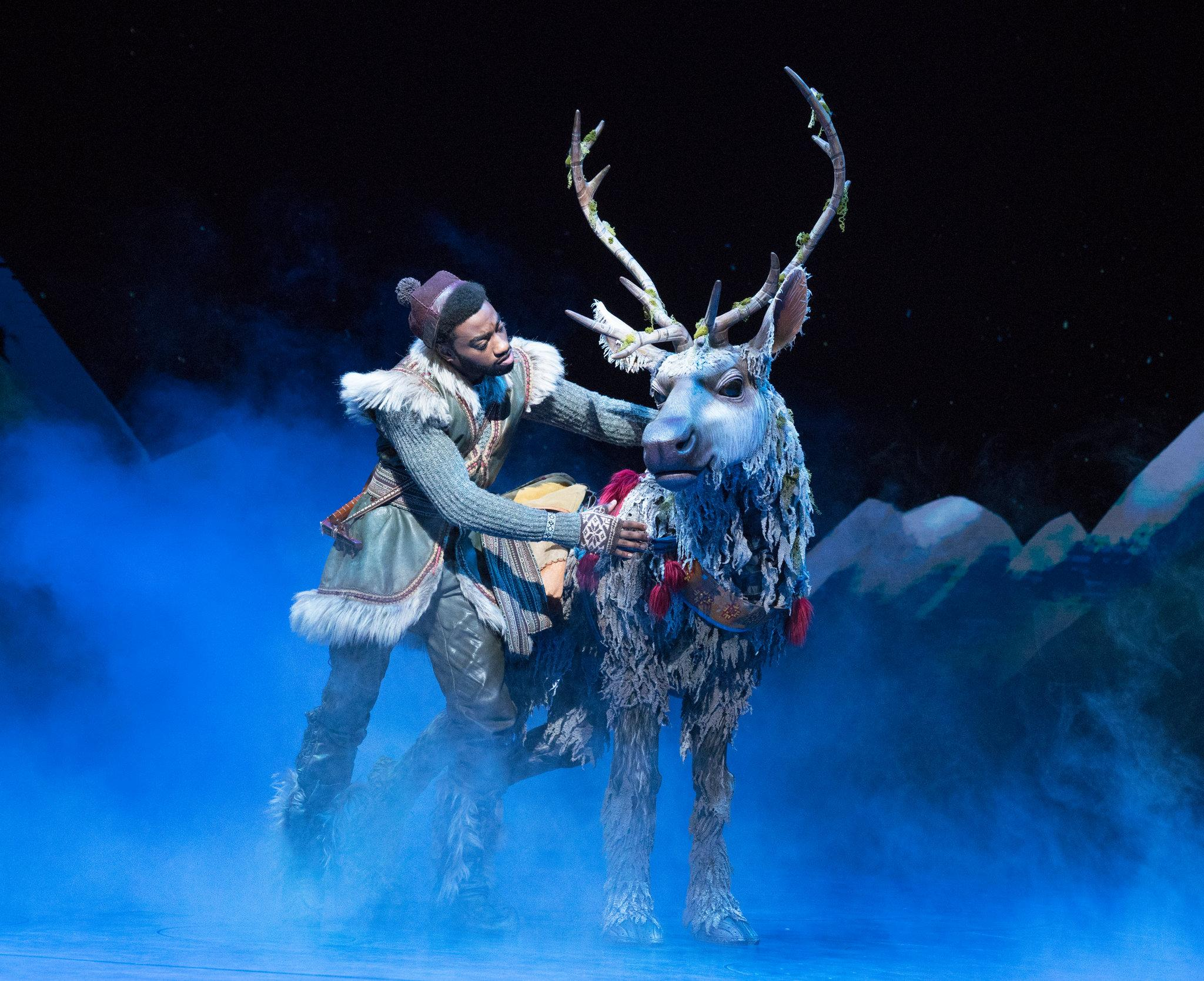 """Supporting characters get their moments, too: Jelani Alladin, left, as Kristoff and Andrew Pirozzi as the reindeer Sven."" Credit: Sara Krulwich/The New York Times."