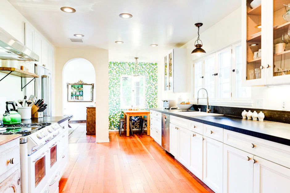Oh hello cute kitchen with black soapstone counters.  The punch of their kelly green wallpaper in the eating nook is to die for.