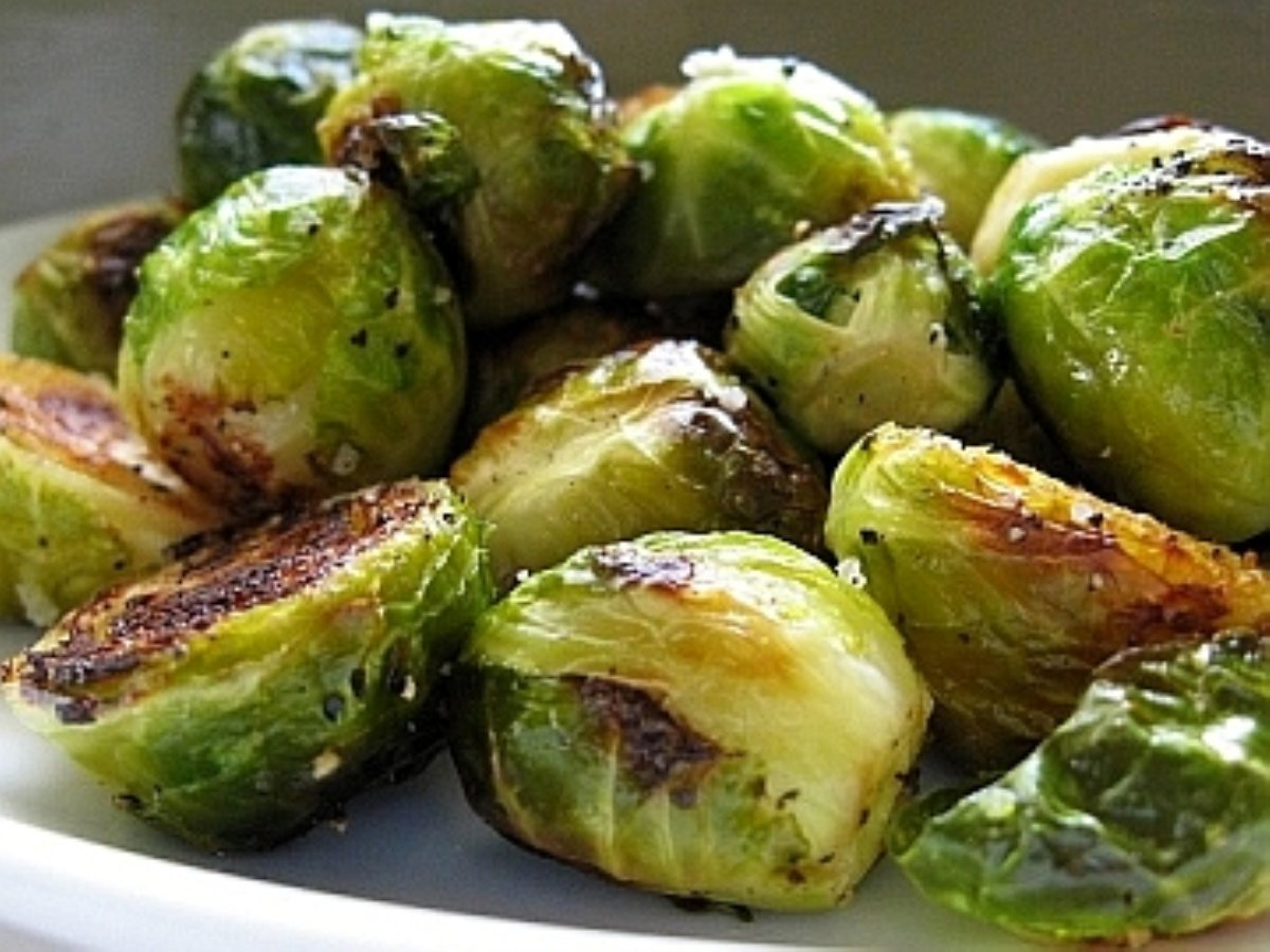 Roasted Brussels are too easy!  Cut in half, drizzle OO, course salt, pepper and pop in the oven at 450 until tops are crispy and golden.  Voila!