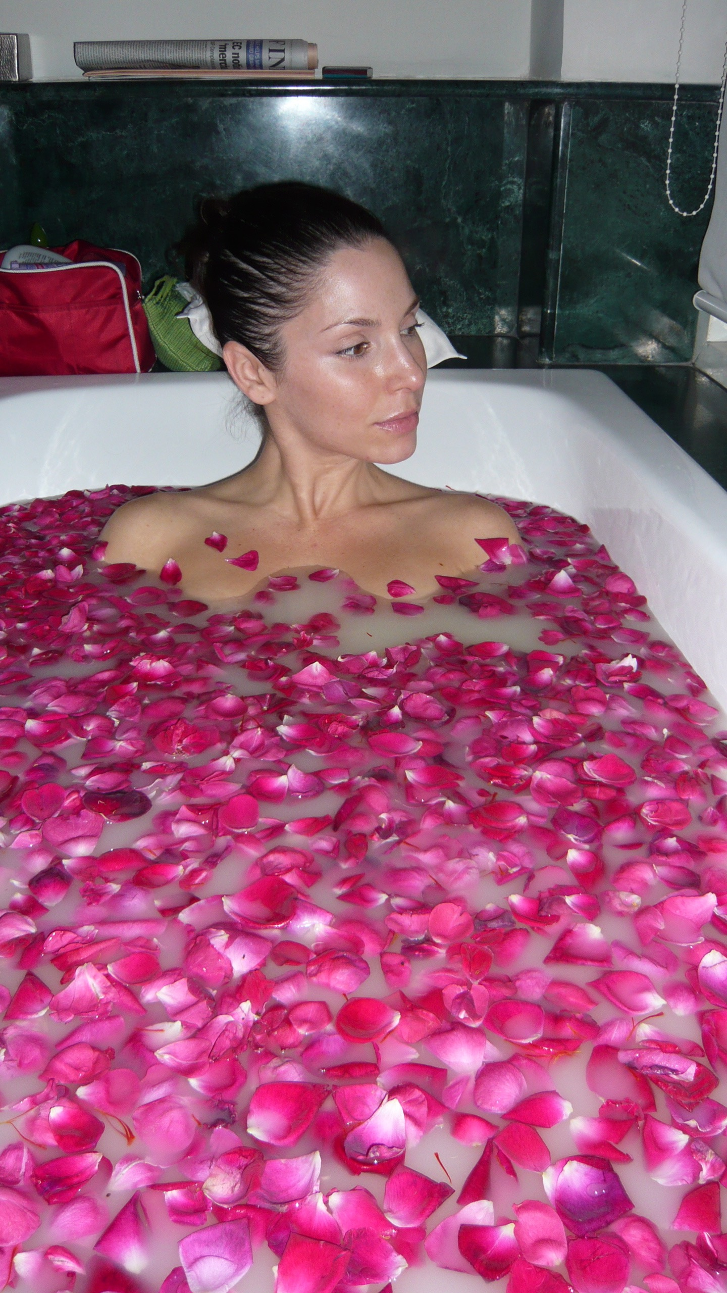 Oh yeah this actually happened once upon a time! A rose, turmeric, coconut bath in India!. Now if I could only have that young, wrinkle free skin again...