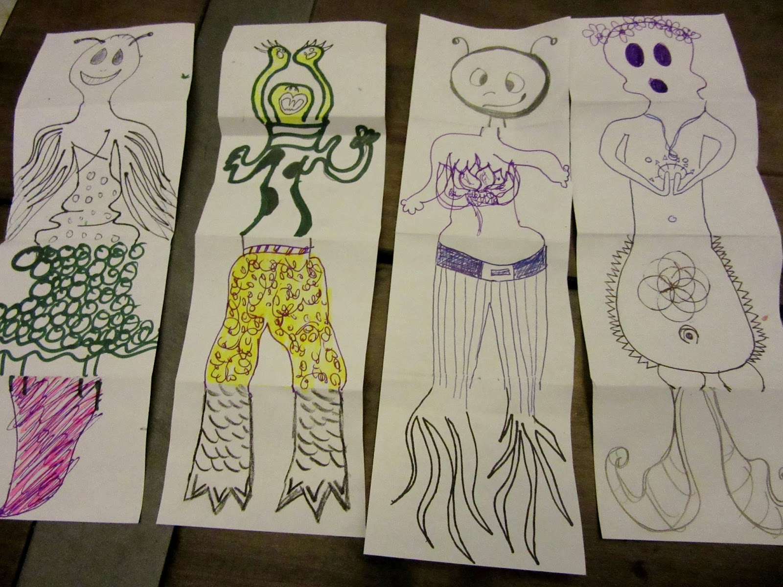Found these examples on  http://bld-in-mt.blogspot.com/2015/07/drawing-games-exquisite-corpse.html