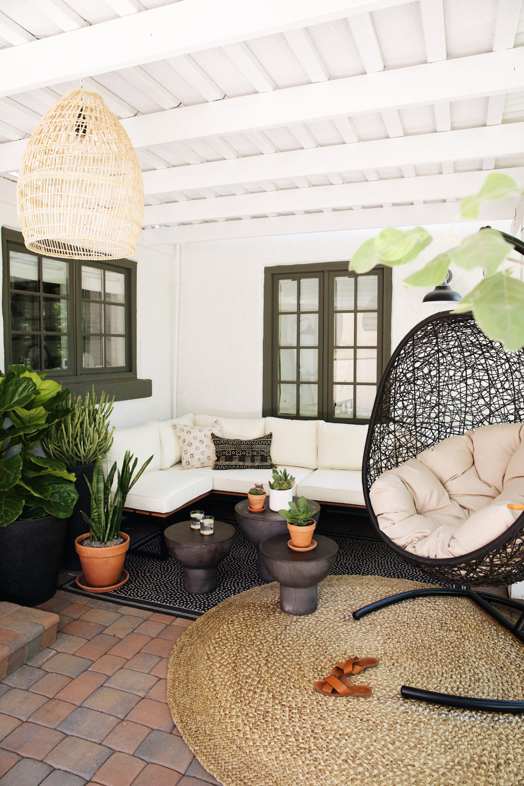 This space from the New Darlings was really easy for them to achieve.  New rugs, side tables, simple couch, plants and a hanging chair...voila!