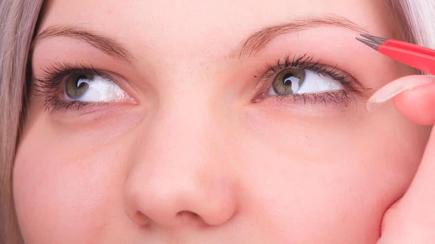 Beautiful-girl-plucking-eyebrows-with-tweezers.jpg