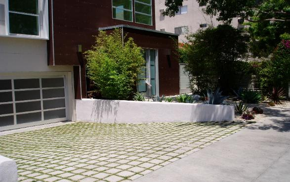 Green driveway built with permeable concrete paving stones and grass joints.  West Hollywood Condominium. Design/Build  KRM Garden Management