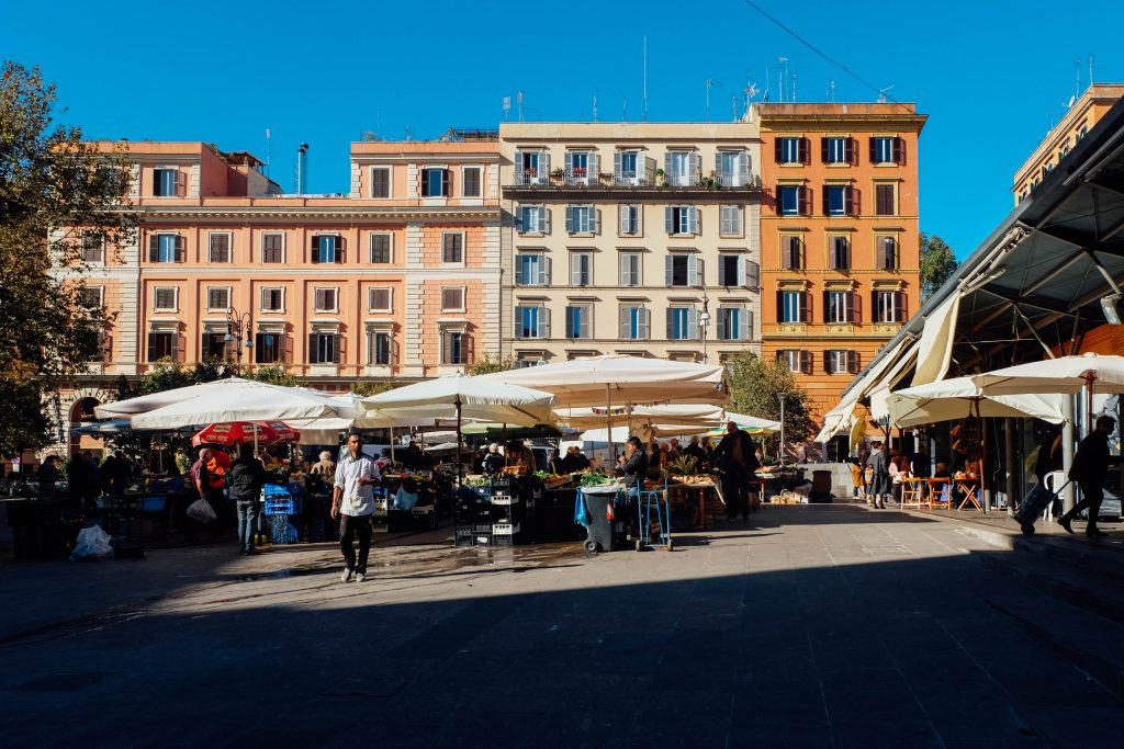 Piazza San Cosimato, Rome - This piazza is located in the Trestevere District/neighborhood of Rome. I spent a month studying abroad in Rome one summer and our apartment during that time was a block away from this piazza. Every morning before our class met up for tours I would go to a cafe next to this space, order a cappuccino and just watch people set up for the daily market. I enjoyed seeing how people interacted with one another in a way that was quite different than Americans do. The sights, sounds, smells, all seemed to form a ballet of life.photo: An American in Rome