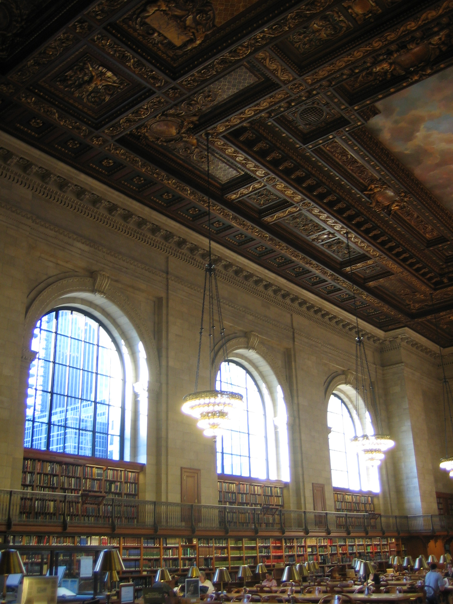 Third Floor Reading Room, New York Public Library at Bryant Park - Sometimes a room becomes more than a room, and the reading room on the third floor of the NYPL at Bryant Park is just that. Housed inside a stunning Beaux-Arts building, the reading room is perhaps the most magnificent space in the entire city. We become architects to make spaces like this. The reading room fools by making the pursuit of perfect edifice achievable, but it laughs at mortals and continues to hide its secrets within the walls, desks, books and streams of perfect afternoon light.photo: Jonathon