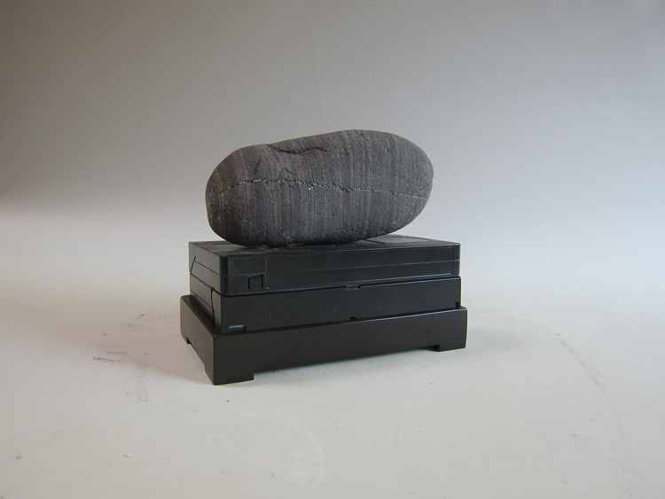 Atlantic Ocean beach stone, VCR cassette, enamel paint, wood