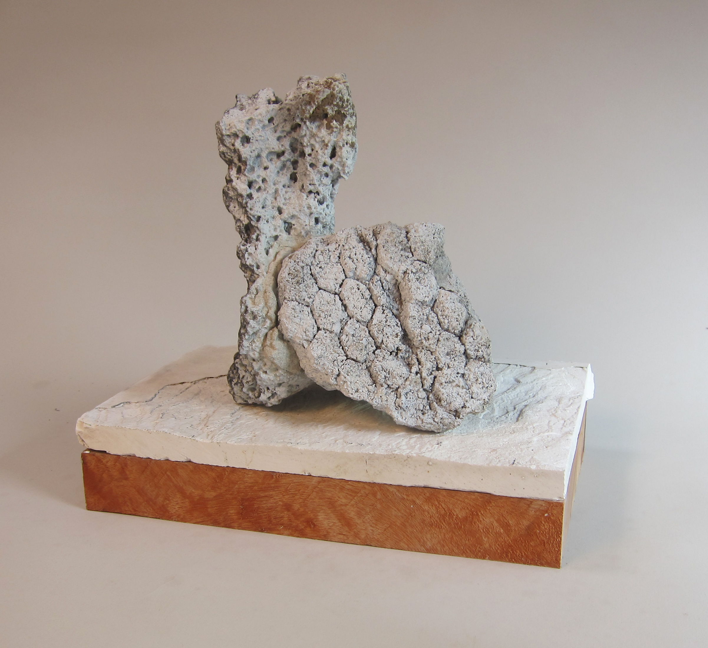 Volcanic stone, concrete rubble, plaster, wood enamel paint