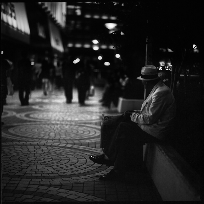 old guy sitting down in shinjuku