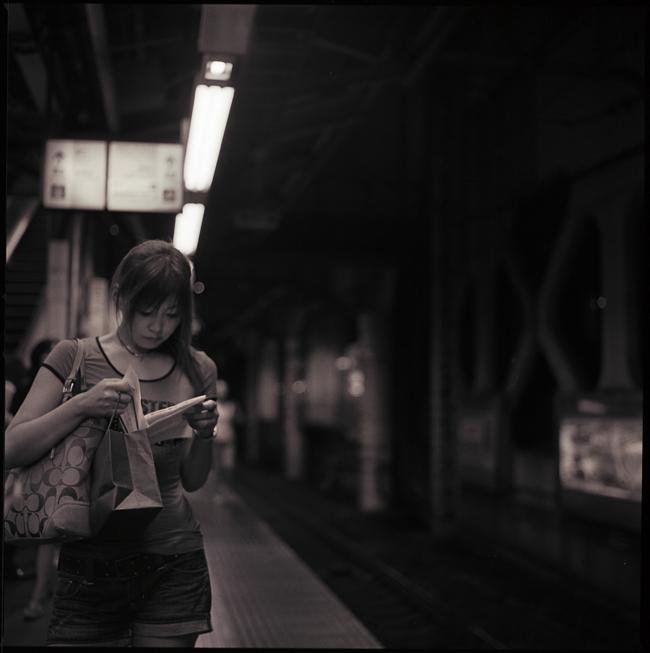 girl reading on the platform
