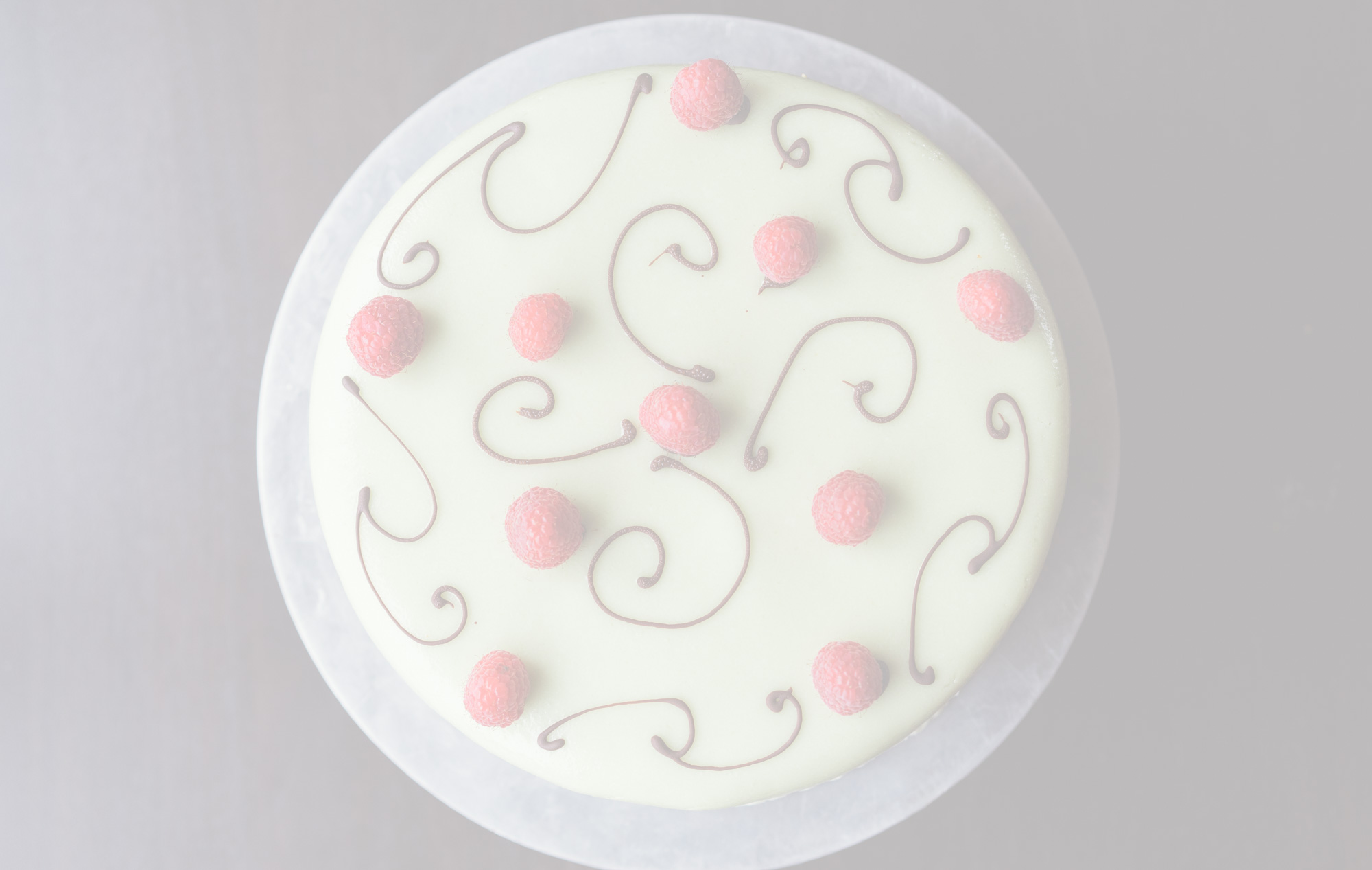 Marzipan$43.95 - Layers of yellow cake and raspberry mousse, topped with marzipan.