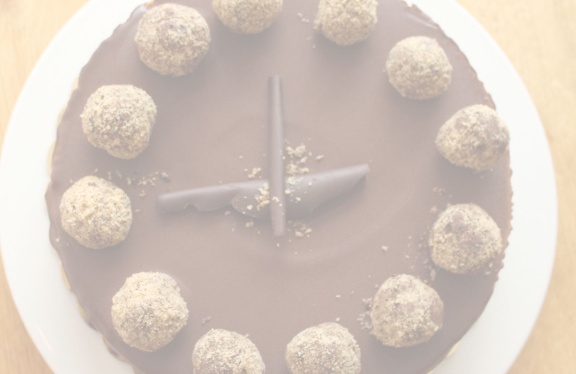 hazelnut cheesecake$43.95 - Hazelnut & traditional cheesecake layers with a hazelnut & Oreo crust topped with a ganache glaze & chocolate truffles.