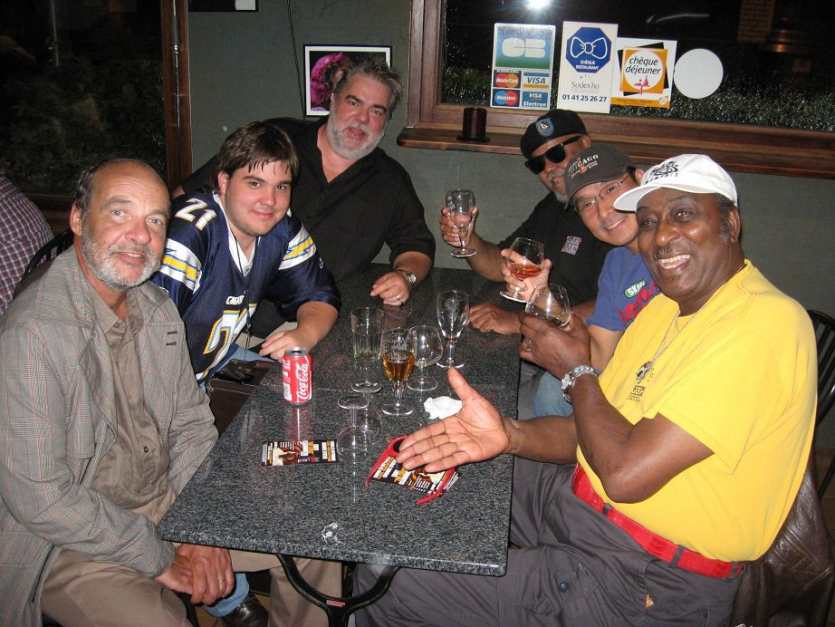 Didier Tricard and stuff members in France with Merle Perkins, Shoji Naito and Eddy Clearwater