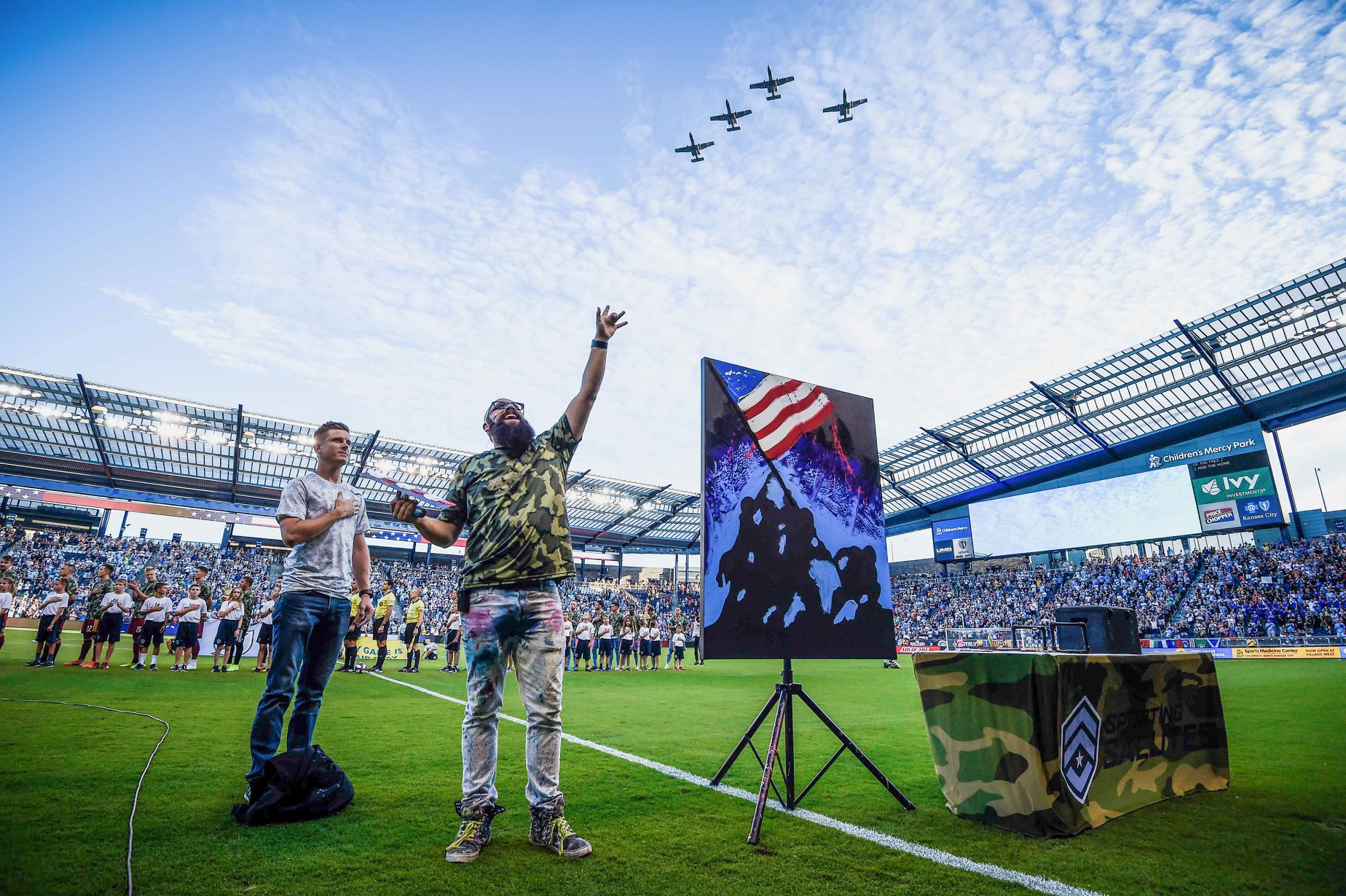 F.I.S.H. at Sporting KC honoring our FISH Aaron Bono with his service dog Max. - F.I.S.H. artist Joe Everson and Everett Callan performed at the match. Note the A-10's overhead.