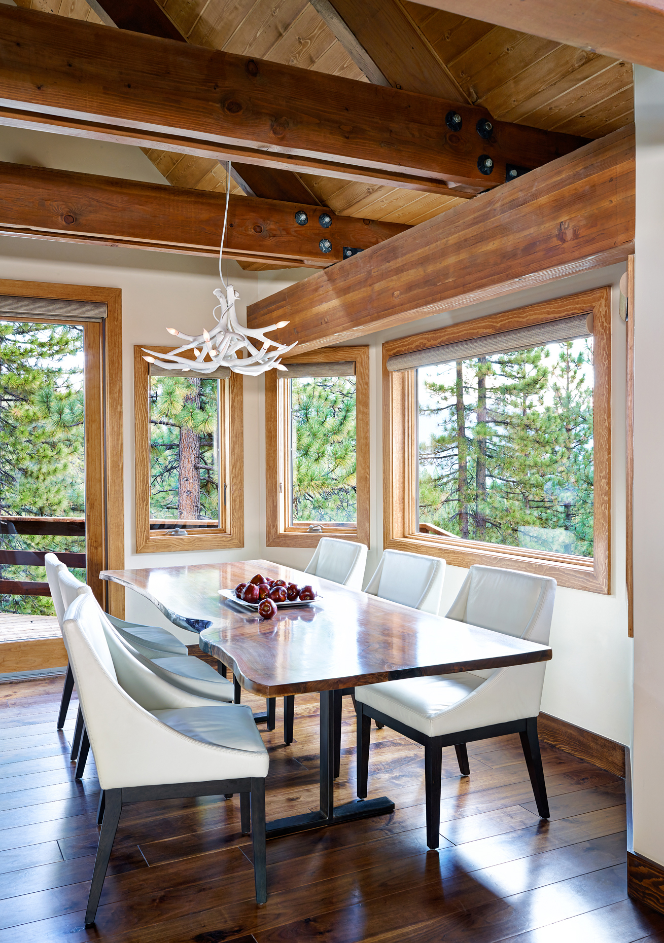 rustic-dining-area-w-slab-dining-table-overstretching-rafters-and-amazing-views