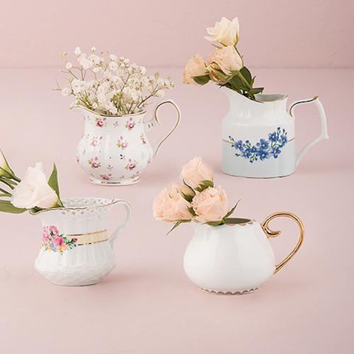 VINTAGE CREAMERS/FLOWER VASES