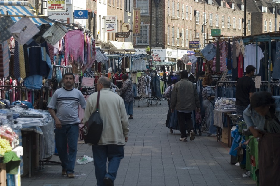 Petticoat Lane Market specialises in economy textiles. The stalls extend down Middlesex Street and along Wentworth Street
