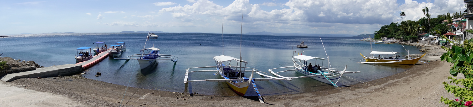 Banca boats ready to take divers to see the amazing cast of creatures awaiting in Anilao.