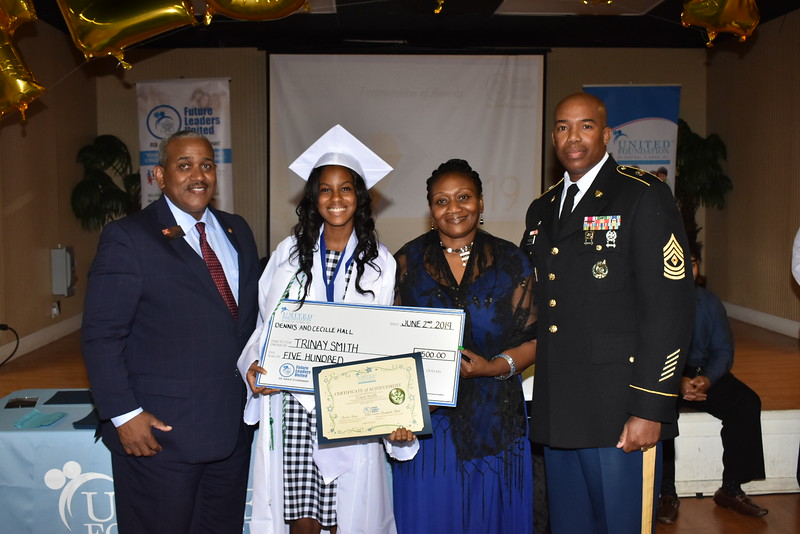 Trinay being notified that she was nominated to receive the Minuteman Scholarship Presented by the Honorable Allie L. Braswell, Jr. Civilian Aide to the Secretary of the Army and 1SG Ringrose  Left to Right: Honorable Allie L. Braswell, Jr, Trinay Smith, Ms. Sandra Fatmi, 1SG Ringrose