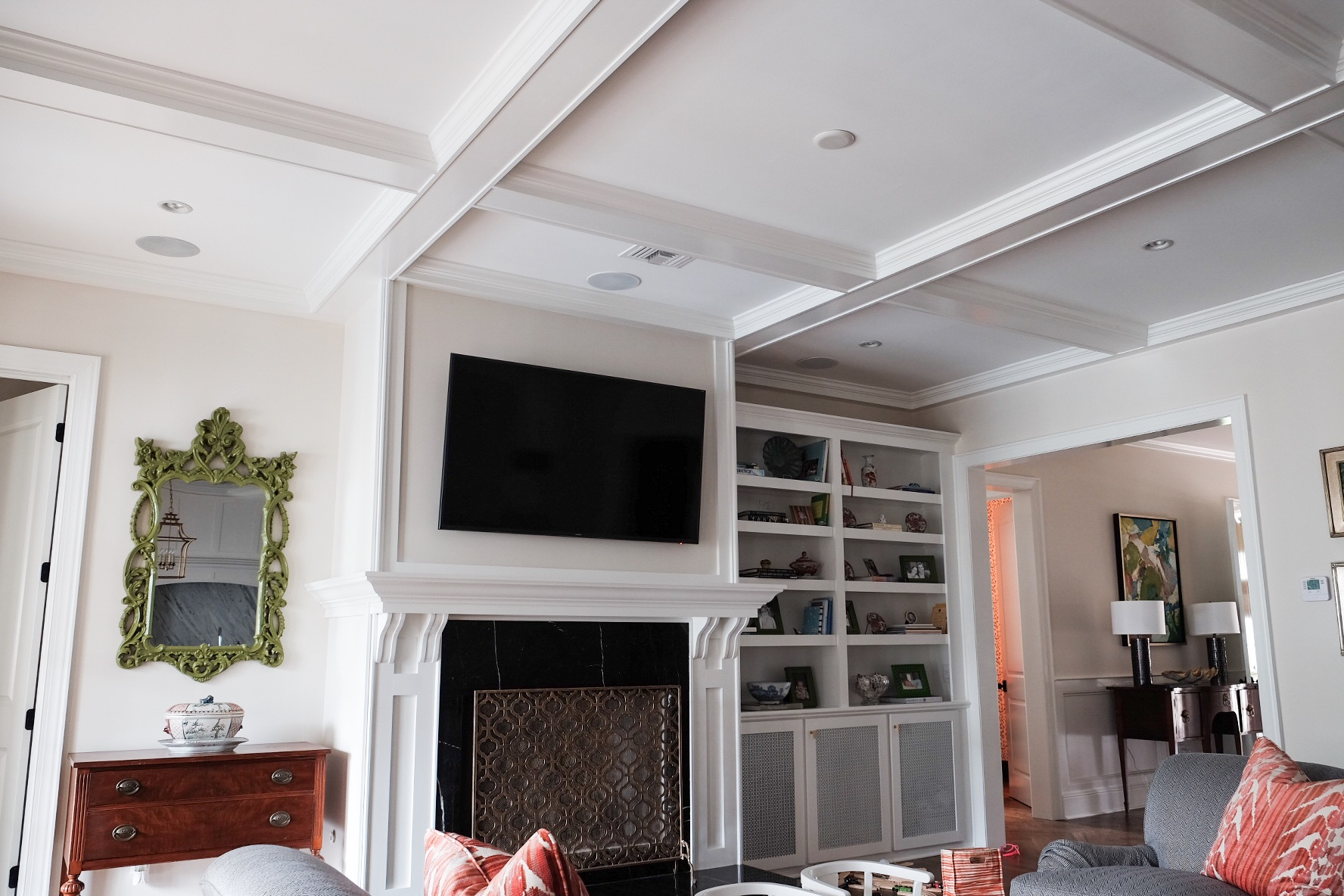 custom fireplace surround, mantle, built in, and coffered ceilings | Tampa, FL