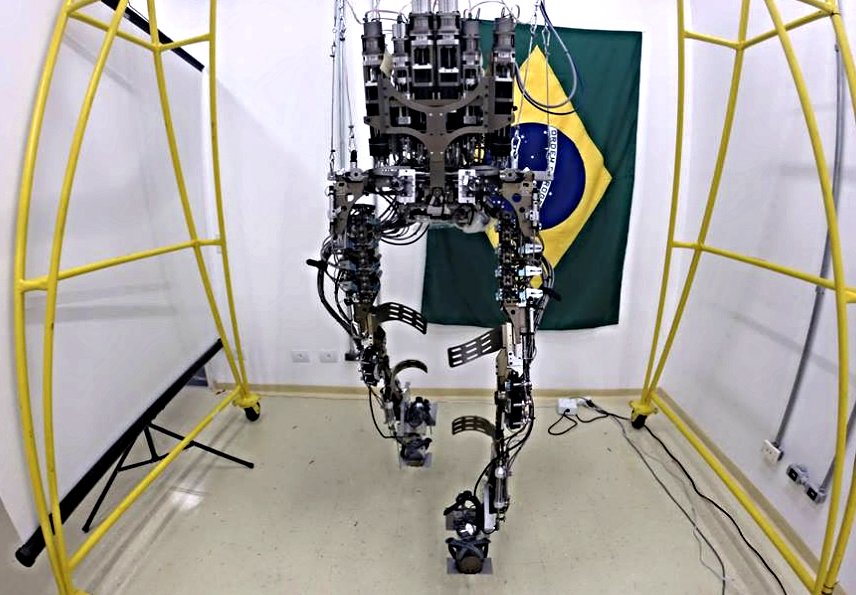 PopSci.com   Robotic Exoskeleton To Kick Off The World Cup  If all goes according to plan, at the  2014 World Cup  opening ceremony in Sao Paolo tomorrow, a paralyzed person will rise from a wheelchair, take several steps, and kick a soccer ball into a goal. The feat will be accomplished thanks to the Walk Again Project, a battery-powered, mind-controlled exoskeleton developed by an international team of scientists. According to the lead scientist on the project, Duke University neuroscientist Miguel Nicolelis, Ph.D., the kick will be a signal to the world that wheelchairs will soon become obsolete.