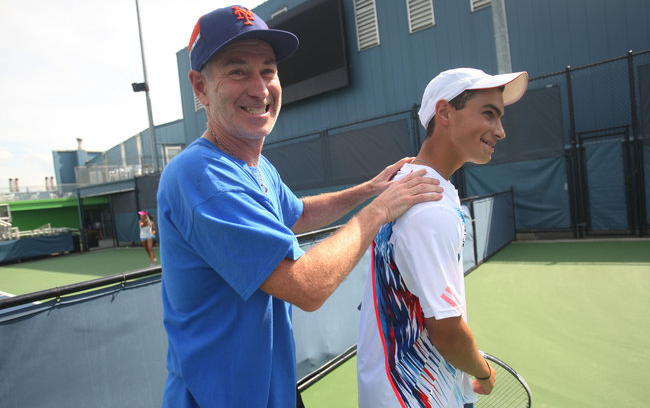 The New York Times   Developing Top Talent or Hindering Process?  The 16th-ranked junior player was rallying at the Sportime tennis center on Randalls Island on a recent afternoon when the owner of the tennis academy there swaggered onto the court for a peek at one of his pet projects, Noah Rubin. That owner is John McEnroe, revered as one of the sport's greats, with a style all his own.