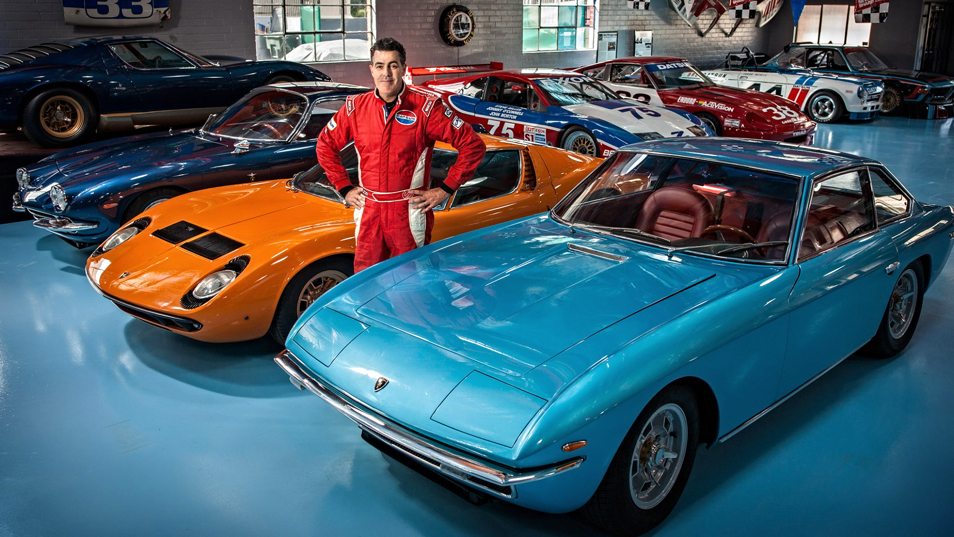 """Forbes   How Adam Carolla Became the World's Greatest Paul Newman Racecar Collector  Before breaking into Hollywood, comedian Adam Carolla spent 12 years in construction. Now he spends 12 hours a week on his podcast venting about everything from government handouts to specious """"service"""" dogs on airplanes to proper pizza toppings. He approaches everything with an I-can-do-it-better-myself attitude. It drives his most passionate pursuit: restoring Paul Newman's race cars.He has spent nearly $1 million acquiring and will spend another $1 million rebuilding seven of Newman's race cars–the largest known collection in the world."""