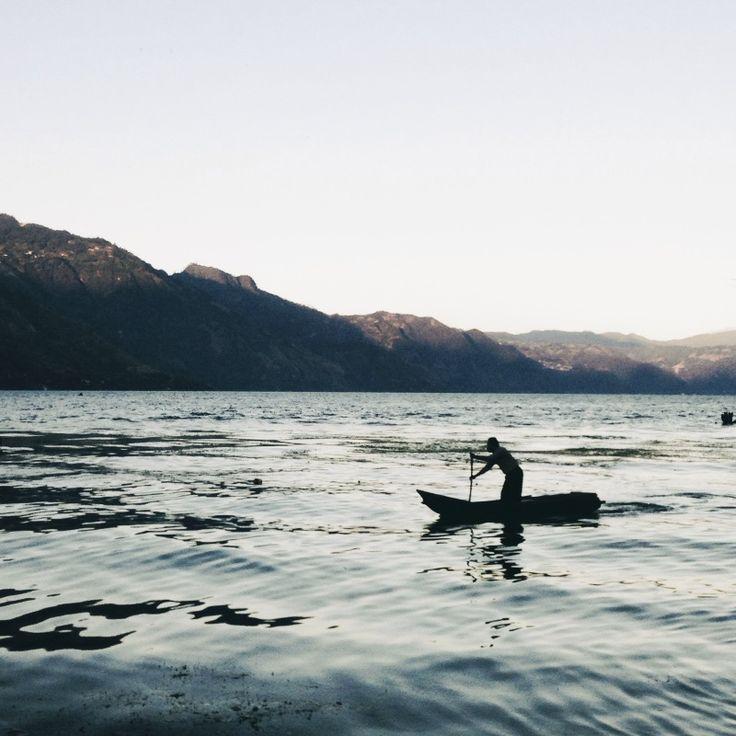 guatemala lake atitlan man on canoe