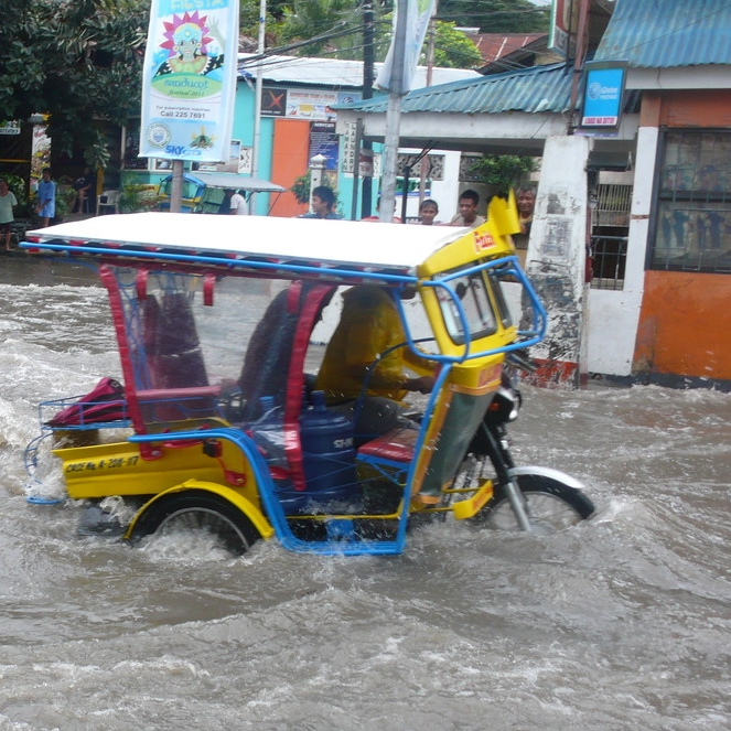 hurricane in the philippines flooding scooter road