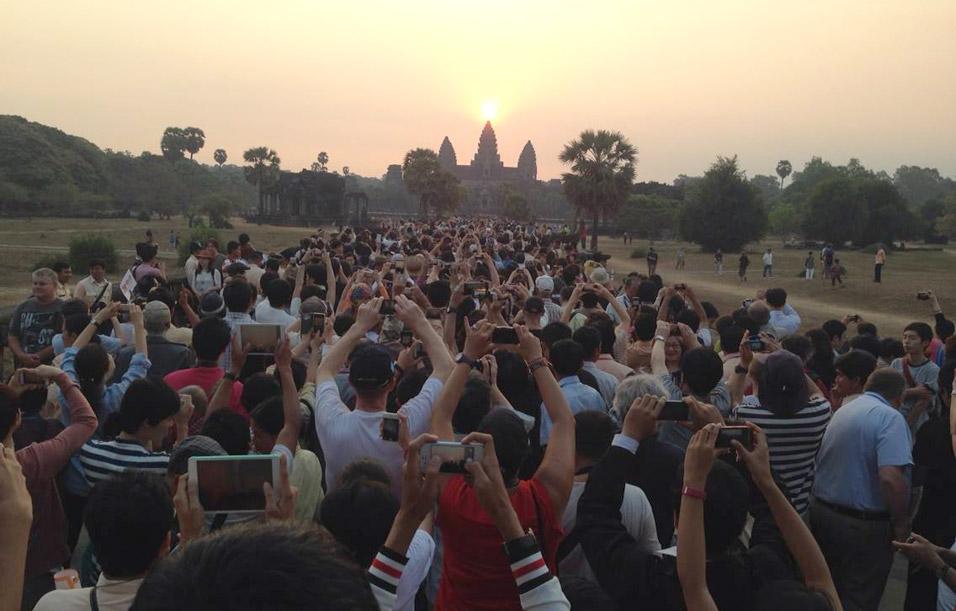 crowd at angkor wat temples travel backpack