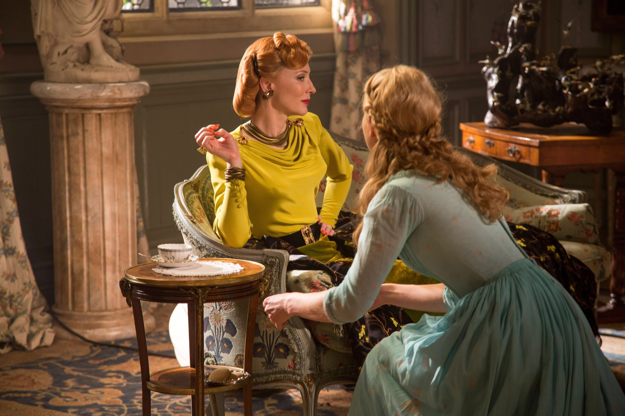 Cate Blancett as Lady Tremaine and Lilly James as Ella.