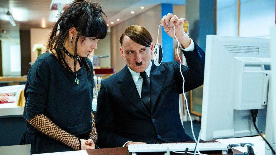 Franziska Wulf as Fraulein Kromeier and Masucci as Hitler