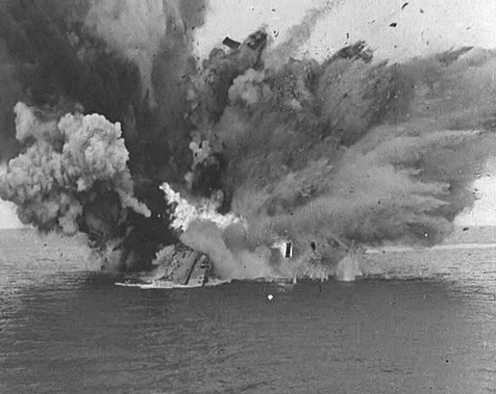 HMS  Barham  exploding after being stuck by three torpedos from  U-331  in 1941