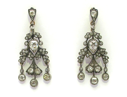 4.15cts of old mine, rose cut and antique pear diamonds set in silver, backed in 18k rose gold.