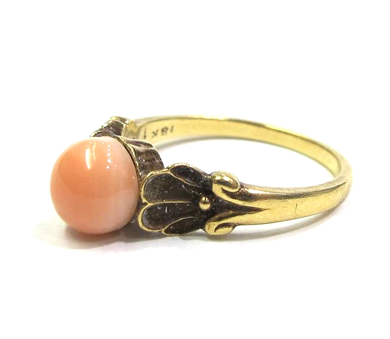 18K yellow gold ring with coral cabouchon, signed G. Jensen, at Gray & Davis.