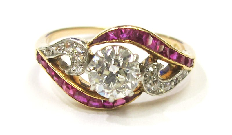 14k rose gold/platinum ring with .65ct I color, SI1clarity Old European diamond center and ruby accents. Viennese assay marks c.1900
