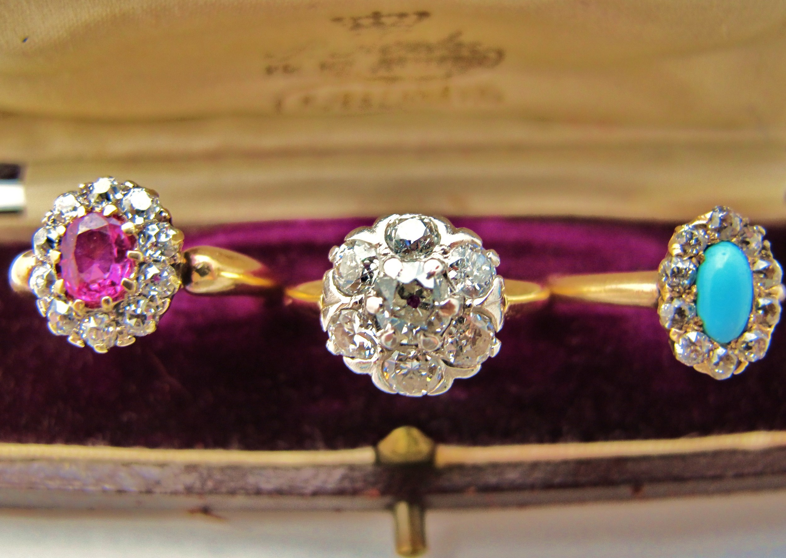 From Right to Left: 18k yellow gold with .56ct ruby and old European diamond surround, 14k yellow gold/platinum with 1.4cts of old European cut diamonds, 14k yellow gold with Persian turquoise cabochon and old European cut diamond surround.
