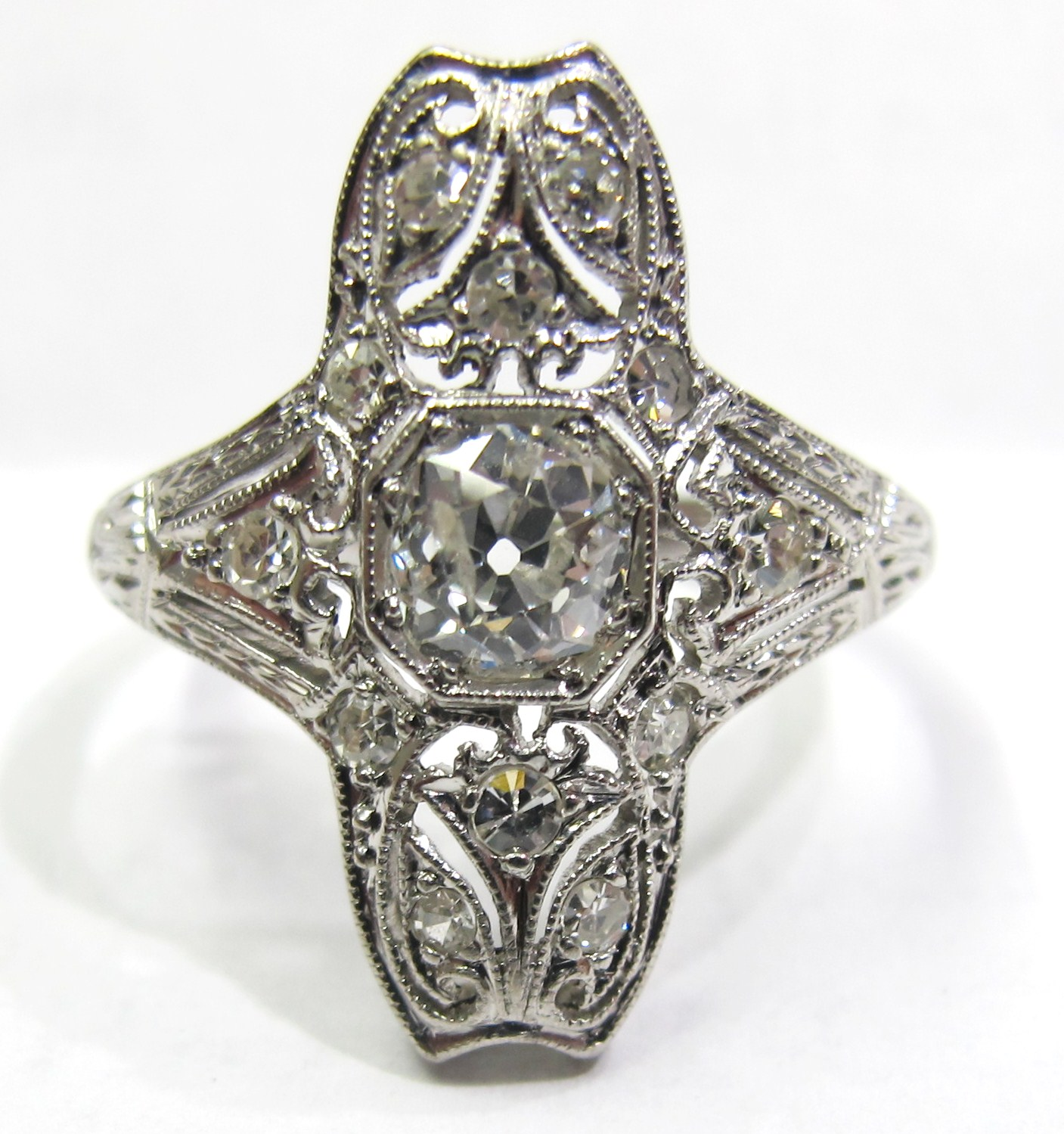 Fashioned in platinum with .45ct F color, I1 clarity old mine cut center diamond and single-cut diamond accents. Made c.1905.